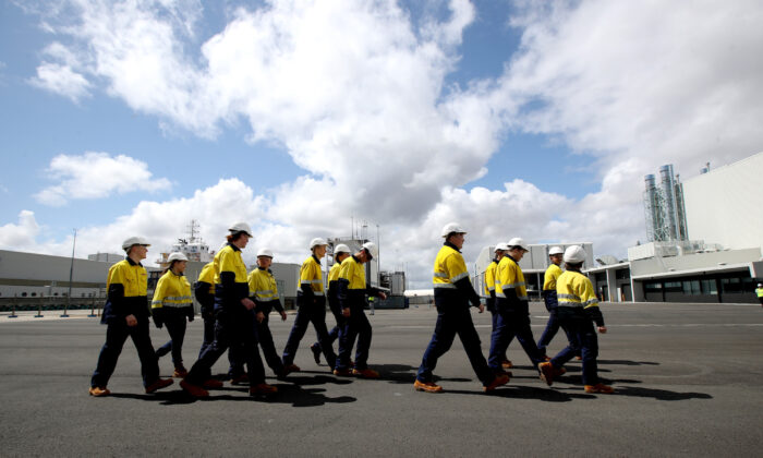 Apprentice ship builders walk at Osborne Naval Shipyard during a visit by Australian Prime Minister Scott Morrison in Adelaide, Australia on Sept. 26, 2020. (Kelly Barnes/Getty Images)
