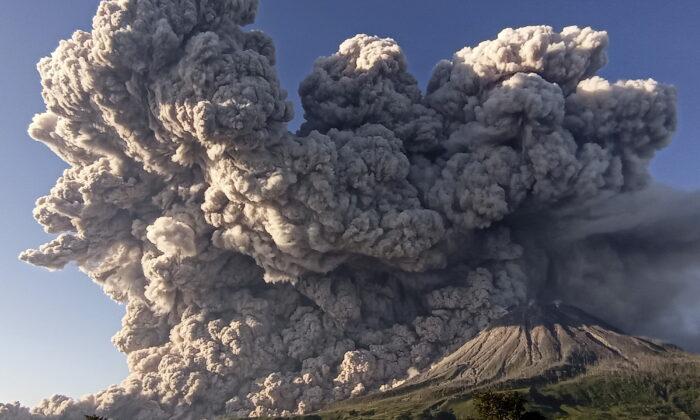 Mount Sinabung volcano erupts as seen from Kuta Rakyat village in Karo, North Sumatra Province, Indonesia, on March 2, 2021. (Antara Foto/Sastrawan Ginting/via Reuters)