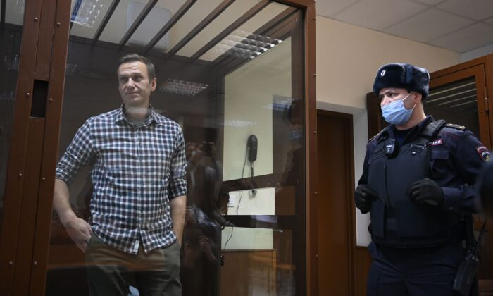 Russian opposition leader Alexei Navalny stands inside a glass cell during a court hearing at the Babushkinsky district court in Moscow on Feb. 20, 2021. (Kirill Kudryavtsev/AFP via Getty Images)