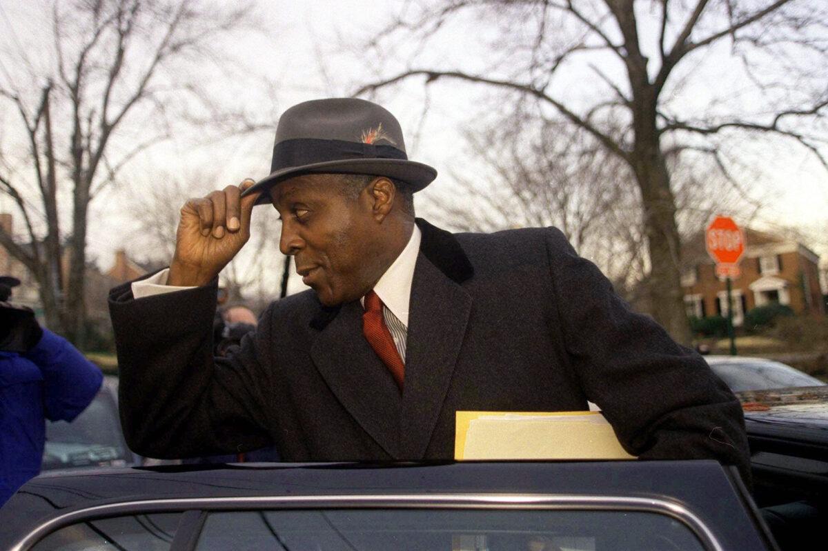Vernon Jordan leaves his home