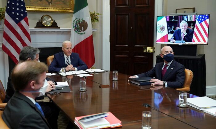 President Joe Biden and Homeland Security Secretary Alejandro Mayorkas look up during a virtual bilateral meeting with Mexican President Andres Manuel Lopez from the White House in Washington, on March 1, 2021. (Kevin Lamarque/Reuters)