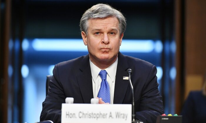 FBI Director Christopher Wray arrives to testify before the Senate Judiciary Committee on the January 6th insurrection, in the Hart Senate Office Building on Capitol Hill in Washington, on March 2, 2021. (Mandel Ngan/Pool via Reuters)