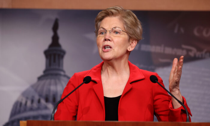 Sen. Elizabeth Warren (D-Mass.) holds a news conference to announce legislation that would tax the net worth of America's wealthiest individuals, at the Capitol in Washington on March 1, 2021. (Chip Somodevilla/Getty Images)