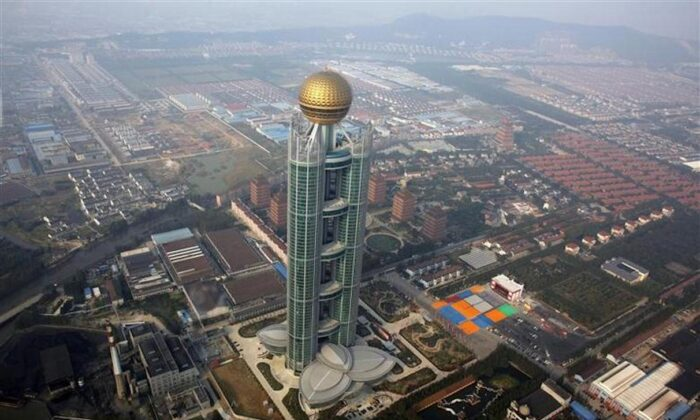 A newly inaugurated skyscraper tower in Huaxi Village, China, on Oct. 7, 2011. (Carlos Barria/Reuters)