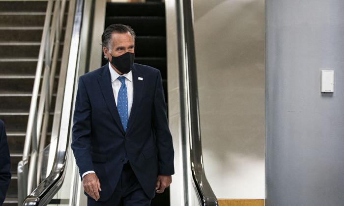 Sen. Mitt Romney (R-Utah) departs following a vote in the subway of the U.S. Capitol in Washington on Feb. 23, 2021. (Al Drago/Getty Images)