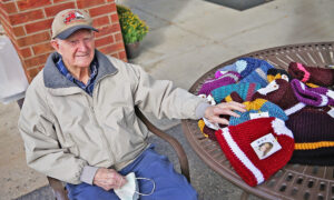WWII Veteran, 96, Knits Hats for the Salvation Army During Pandemic, Weaves Over 500