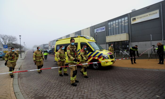 Emergency responders secure the area at the scene of an explosion at a coronavirus disease (COVID-19) testing location in Bovenkarspel, near Amsterdam, Netherlands, on March 3, 2021. (Eva Plevier/Reuters)