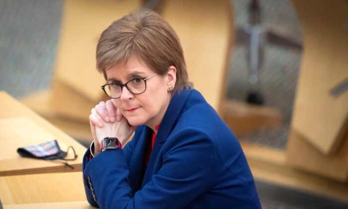 Scotland's First Minister Nicola Sturgeon, attends a COVID-19 briefing at the Scottish Parliament in Holyrood, Edinburgh, Scotland Britain, on March 2, 2021. (Jane Barlow/PA Wire/Pool via Reuters)