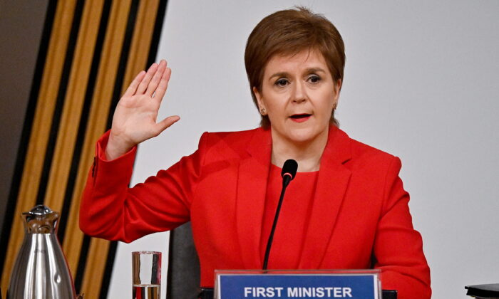 Scotland's First Minister Nicola Sturgeon gestures as she gives evidence to a Scottish Parliament committee examining the handling of harassment allegations against former First Minister of Scotland Alex Salmond, in Edinburgh, Scotland, Britain, on  March 3, 2021. (Jeff J Mitchell/Pool via Reuters)