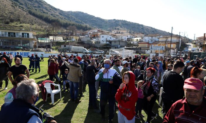 Local residents gather at a soccer field after an earthquake in Damasi village, central Greece, on March 3, 2021. (Vaggelis Kousioras/AP Photo)