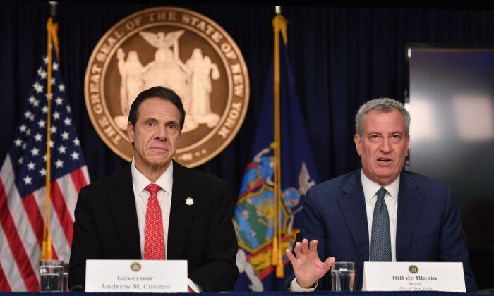 New York Governor Andrew Cuomo (L) and New York City Mayor Bill de Blasio speak during a press conference to discuss the first positive case of novel coronavirus in New York State in New York City on Mar. 2, 2020. (Angela Weiss/AFP via Getty Images)