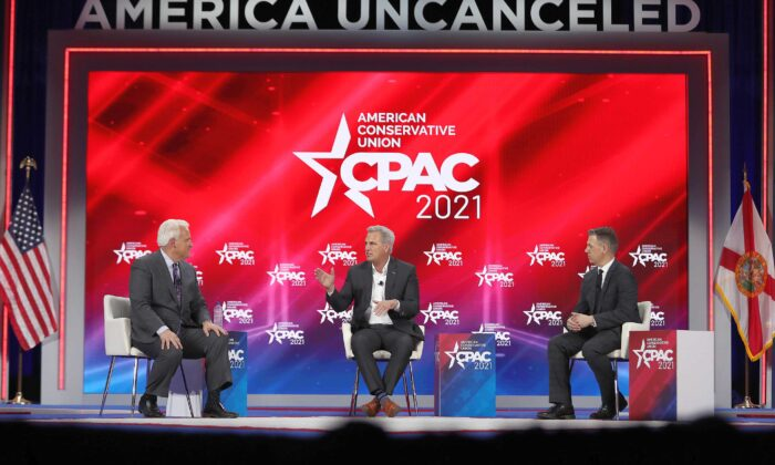 (L-R) Matt Schlapp, Moderator, American Conservative Union chairman, Rep. Kevin McCarthy (R-Calif.), House Minority Leader, and Rep. Jim Banks (R-Ind.), participate in a discussion titled 'Winning Back America' during the Conservative Political Action Conference (CPAC) held in the Hyatt Regency in Orlando, Fla., on Feb. 27, 2021. (Joe Raedle/Getty Images)