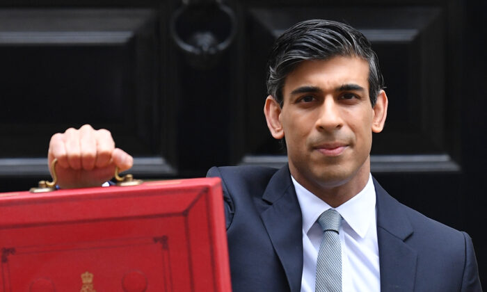 Britain's Chancellor of the Exchequer Rishi Sunak poses with the Budget Box as he leaves 11 Downing Street before presenting the government's annual budget to Parliament in London on March 3, 2021. (Justin Tallis/AFP via Getty Images)