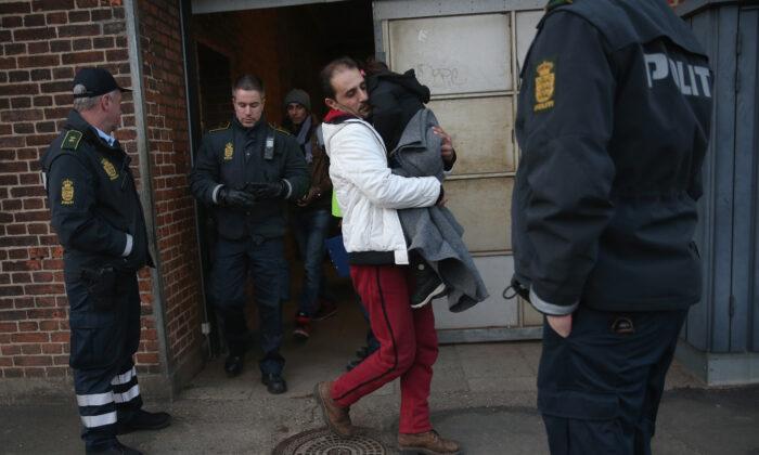 Danish police escort a family from Syria seeking asylum in Denmark  in Padborg, Denmark, on Jan. 6, 2016. (Sean Gallup/file/Getty Images)