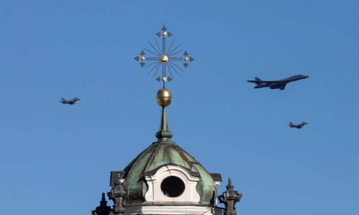 U.S. Air Force Rockwell B-1B Lancer bomber accompanied by two NATO air-policing Italian Eurofighter Typhoons fly over Vilnius, Lithuania, on March 3, 2021. (Ieva Budzekaite/Lithuanian Ministry of Defence/Handout via Reuters)
