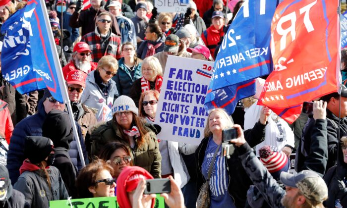 """People gather at the Michigan State Capitol for a """"Stop the Steal"""" rally in support of US President Donald Trump on Nov. 14, 2020, in Lansing, Mich. (Jeff Kowalsky/AFP via Getty Images)"""