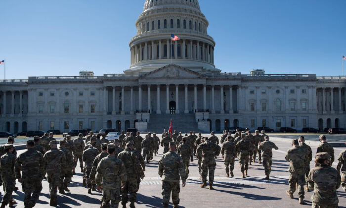 Members of the National Guard are seen on the east front of the U.S. Capitol Building on Capitol Hill in Washington, D.C., on March 2, 2021. (Brendan Smialowski/AFP via Getty Images)