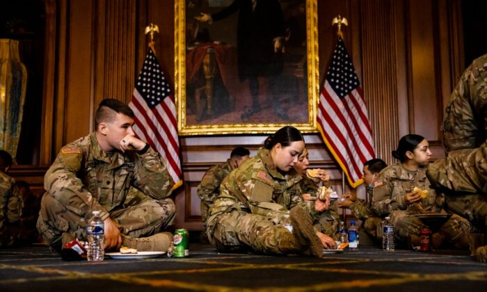 California National Guard troops enjoy breakfast that was provided by House Minority Leader Kevin McCarthy (R-Calif.) as a show of gratitude in the Rayburn Room at the U.S. Capitol in Washington, on Feb. 12, 2021. (Samuel Corum/Getty Images)