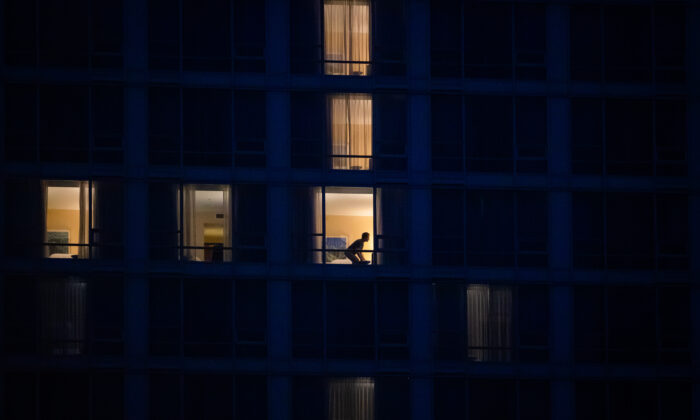A person is seen in a room at a government-authorized COVID-19 quarantine hotel in Richmond, B.C., Canada, on Feb. 28, 2021. (Darryl Dyck/The Canadian Press)