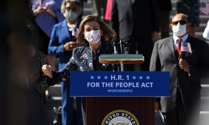 """Speaker of the House Nancy Pelosi (D-Calif.) speaks at an event for the """"For the People Act of 2021"""" on the steps of the Capitol in Washington on March 3, 2021. (Eric Baradat/AFP via Getty Images)"""