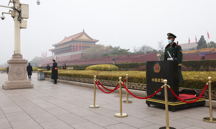 An armed Police officer wears a face mask as he stands guard in front of Tiananmen Gate before the opening ceremony of the fourth session of the 13th National Committee of the Chinese People's Political Consultative Conference (CPPCC) in Beijing, on March 4, 2021. (Lintao Zhang/Getty Images)