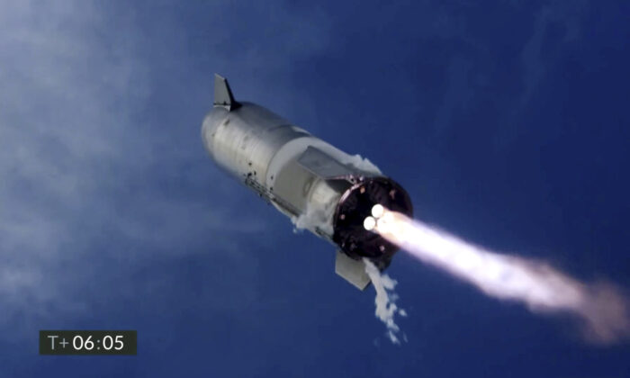 In this image from video made available by SpaceX, one of the company's Starship prototypes fires its thrusters as it lands during a test in Boca Chica, Texas, on Mar. 3, 2021. (SpaceX via AP)