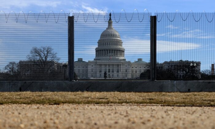 A temporary security fence topped with concertina razor wire surrounds the U.S. Capitol in Washington on Feb. 17, 2021. (Chip Somodevilla/Getty Images)