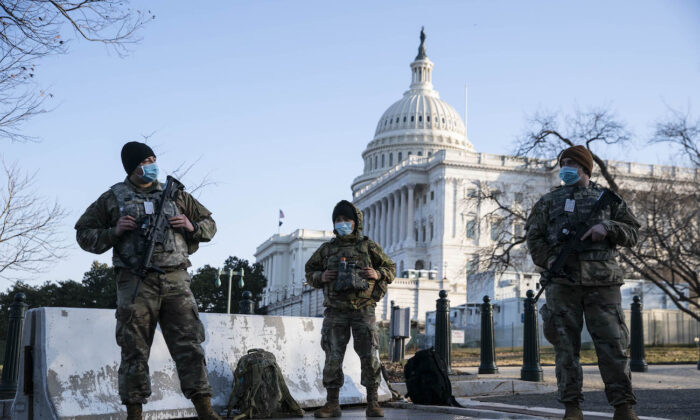 Members of the National Guard wear protective masks on duty outside of the U.S. Capitol in Washington on March 4, 2021. (Sarah Silbiger/Getty Images)