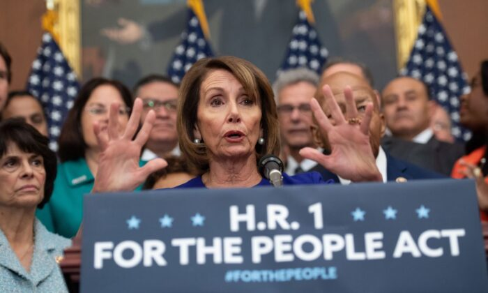 """Speaker of the House Nancy Pelosi (D-Calif.) speaks alongside Democratic members of the House about H.R.1, the """"For the People Act,"""" at the US Capitol in Washington, on Jan. 4, 2019. (Saul Loeb/AFP via Getty Images)"""