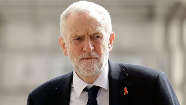 Then-Labour Party leader Jeremy Corbyn arrives at an event at St Martin-in-the-Fields church in London on April 23, 2018. (AP Photo/Matt Dunham, file)