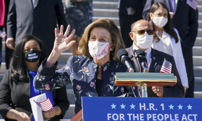 Speaker of the House Nancy Pelosi (D-Calif.)  and the Democratic Caucus gather to address reporters on H.R. 1, the For the People Act of 2021, at the Capitol in Washington, on March 3, 2021. (AP Photo/J. Scott Applewhite)