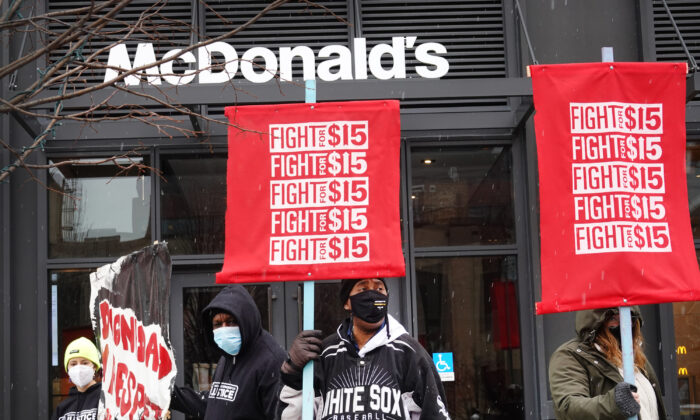 Demonstrators participate in a  protest outside of McDonald's corporate headquarters in Chicago, Ill., on Jan. 15, 2021. The protest was part of a nationwide effort calling for minimum wage to be raised to $15-per-hour. (Scott Olson/Getty Images)
