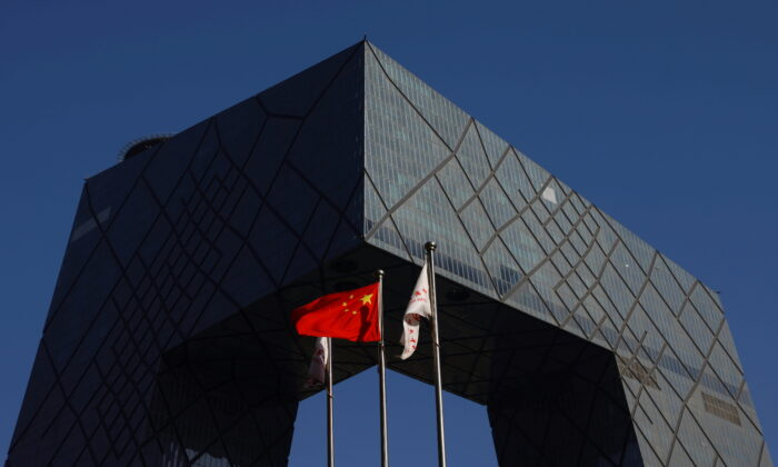 A Chinese flag flutters outside the CCTV headquarters, the home of Chinese state media outlet CCTV and its English-language sister channel CGTN, in Beijing, China on Feb. 5, 2021. (Carlos Garcia Rawlins via Reuters)