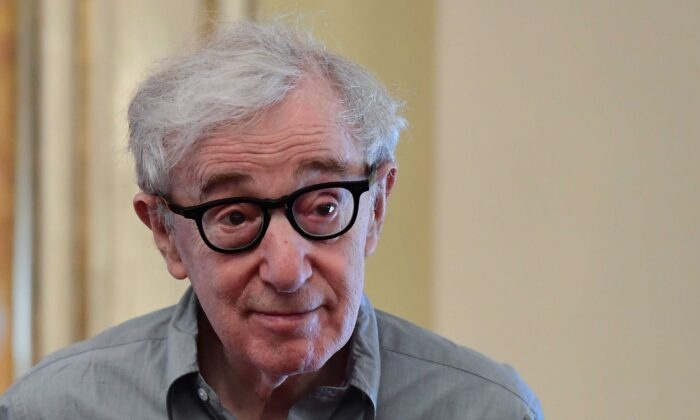 """Woody Allen arrives at a press conference for the presentation of his stage production of Giacomo Puccinis one-act opera """"Gianni Schicchi,""""  at the Scala Opera House in Milan on July 2, 2019. (Miguel Medina/AFP via Getty Images)"""