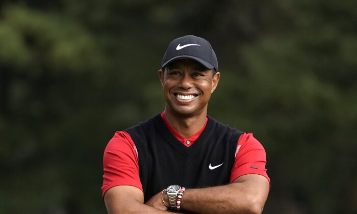 Tiger Woods smiles during the winner's ceremony after winning the Zozo Championship PGA Tour at the Accordia Golf Narashino country club in Inzai, east of Tokyo, Japan, on Oct. 28, 2019. (Lee Jin-man/AP Photo)