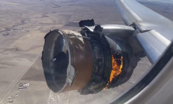 "The engine of United Airlines Flight 328 is on fire after experiencing ""a right-engine failure"" shortly after takeoff from Denver International Airport,  in Denver, Colo., on Feb. 20, 2021. (Chad Schnell via AP)"