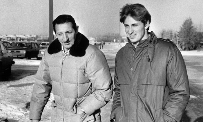 Walter Gretzky and his son Wayne are shown in a 1984 file photo. (The Canadian Press via AP)