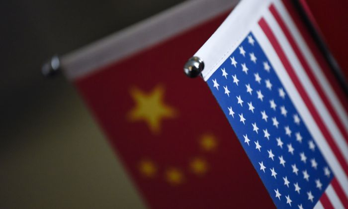 Chinese and American flags are displayed in a company in Beijing, China, on Aug. 16, 2017. (Wang Zhao/AFP/Getty Images)