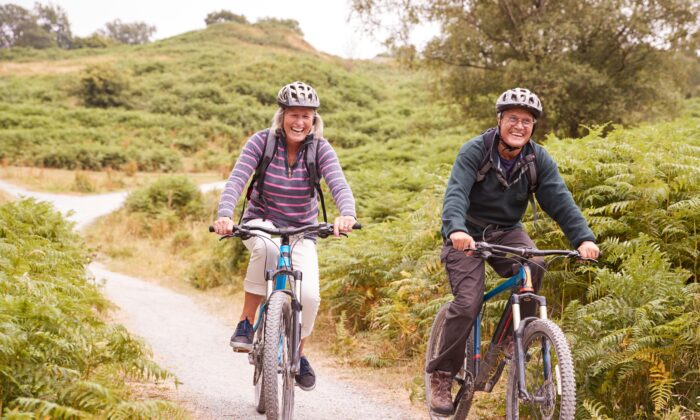 Going out for a walk or bike ride offers exercise with the additional bonus of sunlight, fresh air, and nature. (Monkey Business Images/Shutterstock)