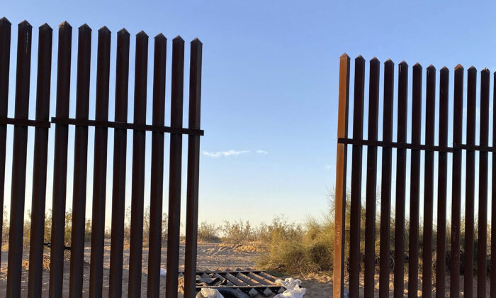 This file photo shows a hole cut into Southern California's border fence with Mexico on March 3, 2021. (U.S. Customs and Border Protection via AP)