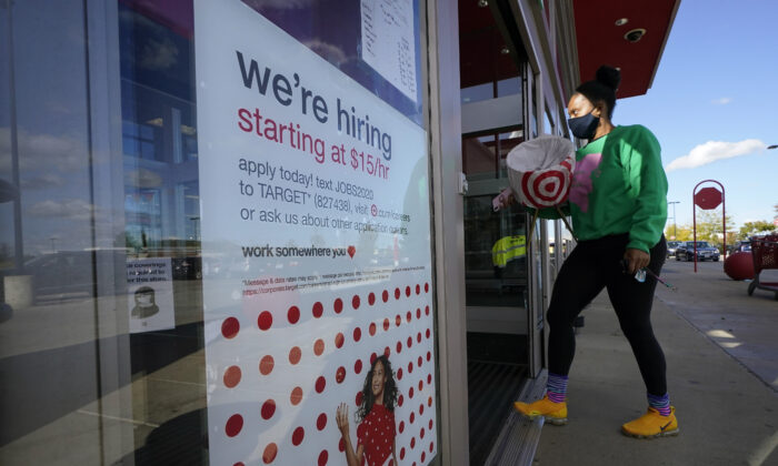 A passerby walks past a hiring sign while entering a Target store in Westwood, Mass., on Sept. 30, 2020. (Steven Senne/File/AP Photo)