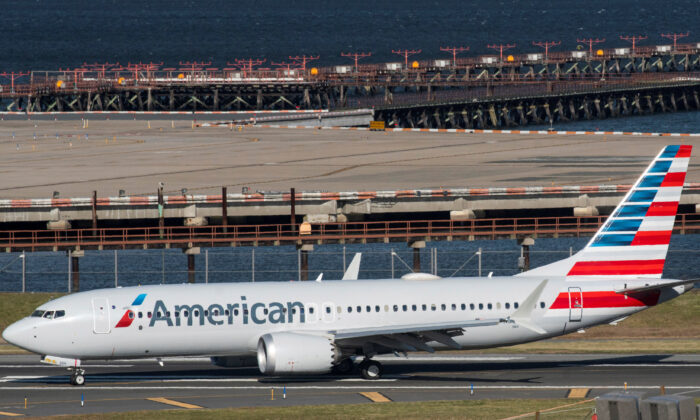 American Airlines flight 718, the first U.S. Boeing 737 MAX commercial flight since regulators lifted a 20-month grounding in November, lands at LaGuardia airport in New York on Dec. 29, 2020. (Eduardo Munoz/Reuters)
