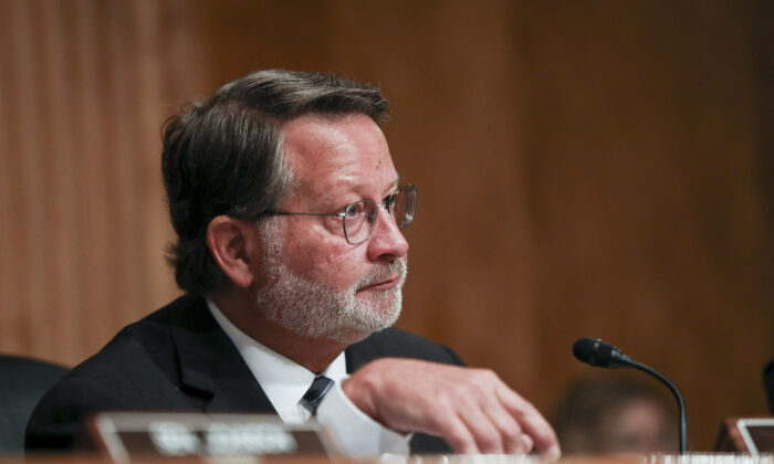 Sen. Gary Peters (D-Mich.) during a Senate Homeland Security Committee in Washington on July 30, 2019. (Charlotte Cuthbertson/The Epoch Times)