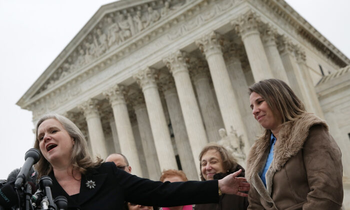 File photo of Sharon Fast Gustafson (L), in her capacity as an attorney representing plaintiff Peggy Young (R), answers questions outside the U.S. Supreme Court, in Washington, on Dec. 3, 2014. (Win McNamee/Getty Images)