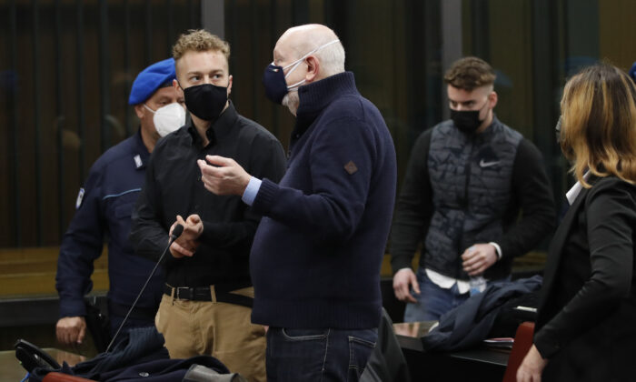 US Finnegan Lee Elder (L), talks with his lawyer Renato Borzone (C), as he arrives with Gabriel Natale-Hjorth (R), for a hearing in the trial where they are accused of slaying the Carabinieri paramilitary police officer Mario Cerciello Rega, while on vacation in Italy in July 2019, in Rome, on March 6, 2021. (Alessandra Tarantino/Pool/AFP via Getty Images)