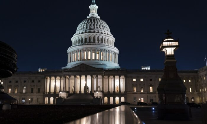 The U.S. Capitol is seen at dusk in Washington on March 5, 2021. (J. Scott Applewhite/AP Photo)