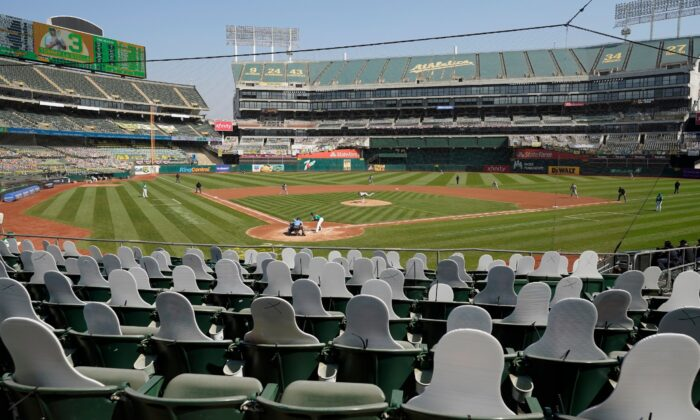Cutouts are seated at Oakland Coliseum as Chicago White Sox's Dallas Keuchel, center, pitches to Oakland Athletics' Tommy La Stella during Game 2 of an American League wild-card baseball series in Oakland, Calif., on Sept. 30, 2020. (Eric Risberg/AP, File)