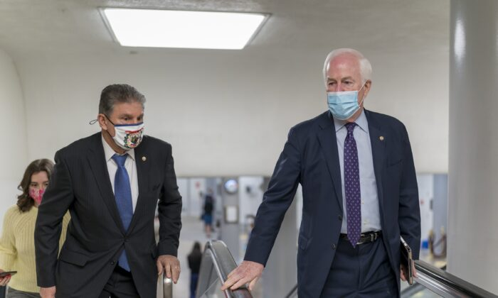 Sen. Joe Manchin (D-W.Va.), left, and Sen. John Cornyn (R-Texas) head to the chamber as the Senate steers toward a voting marathon on the Democrats' $1.9 trillion COVID-19 relief bill that's expected to end with the chamber's approval of the measure, at the Capitol in Washington on March 5, 2021. (J. Scott Applewhite/AP Photo)