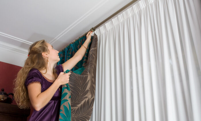 To save yourself save time and money, learn how to hang curtains and curtain rods using a few expert tips. (Dontsov Evgeny/Shutterstock)