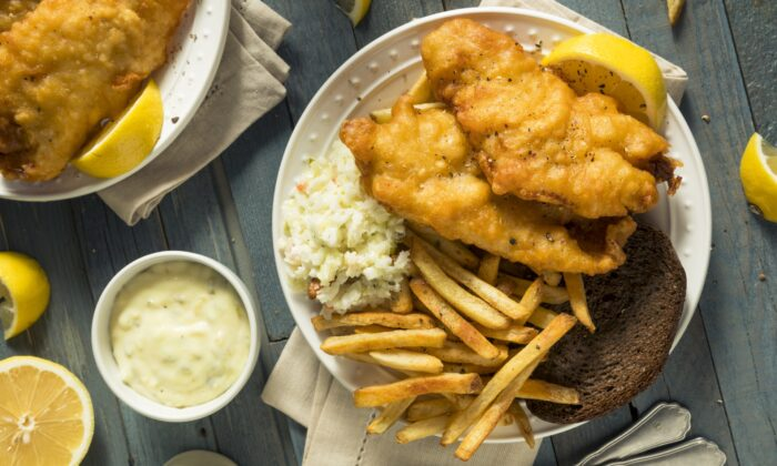 At a typical Friday fish fry, your beer-battered, deep-fried fish comes with a side of coleslaw, maybe a slice of rye bread and pad of butter, and likely French fries or another form of potato. (Brent Hofacker/shutterstock)